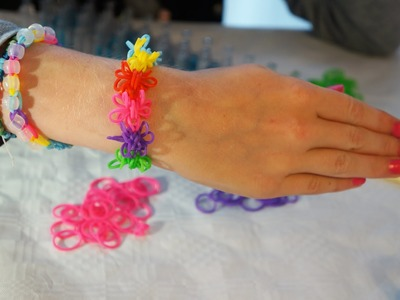 Instructie video Rainbow Loom bloem of sterarmband Nederlands  Deel 2
