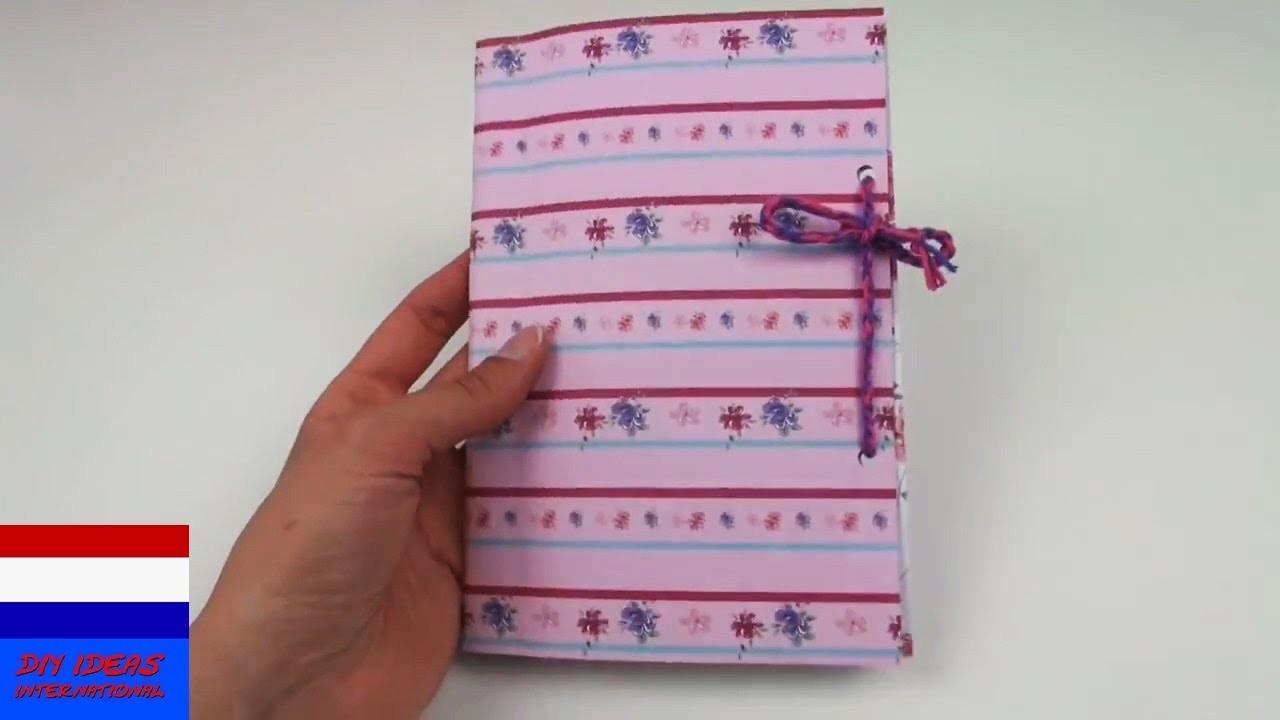 DIY zelf notieboek.huiswerkschrift.dagboek maken met sluiting  - back to school